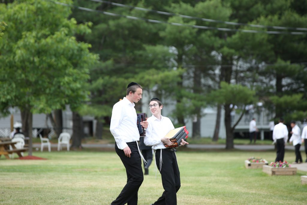 Two bachurim walk in Camp Morris on Tuesday as the Catskills begins to fill with Orthodox Jews for the summer. (JDN)