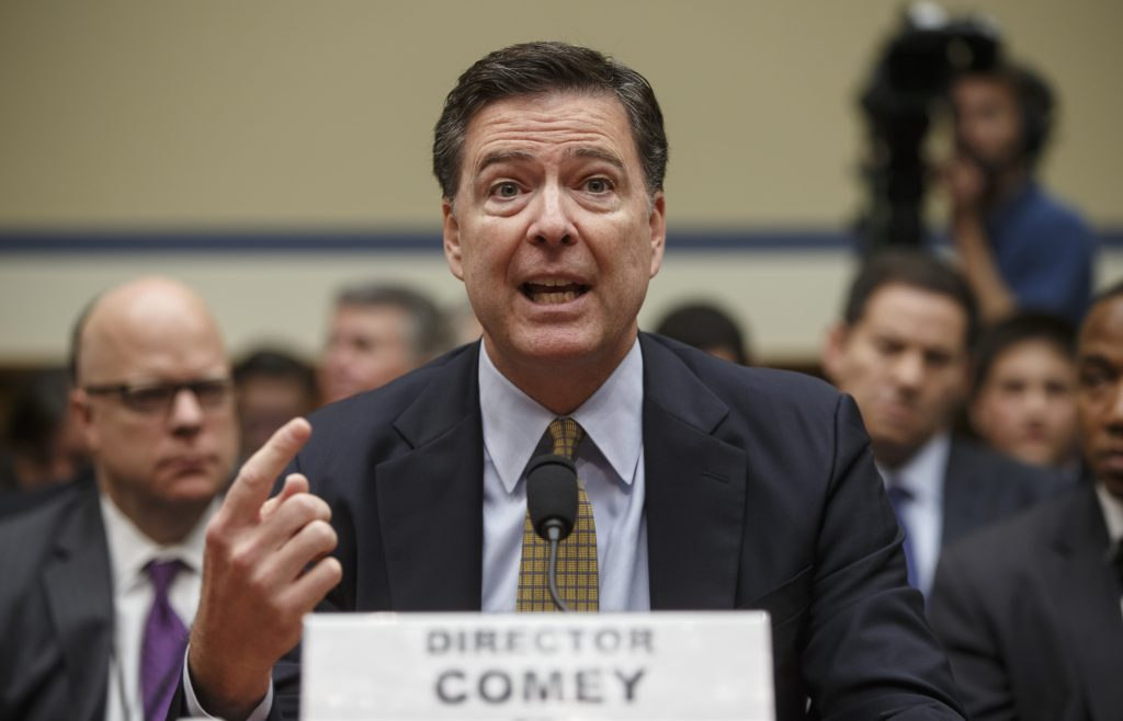 FBI Director James Comey testifies on Capitol Hill in Washington, Thursday, July 7, 2016, before the House Oversight Committee to explain his agency's recommendation to not prosecute Hillary Clinton, now the Democratic presidential candidate, over her private email setup during her time as secretary of state, . (AP Photo/J. Scott Applewhite)