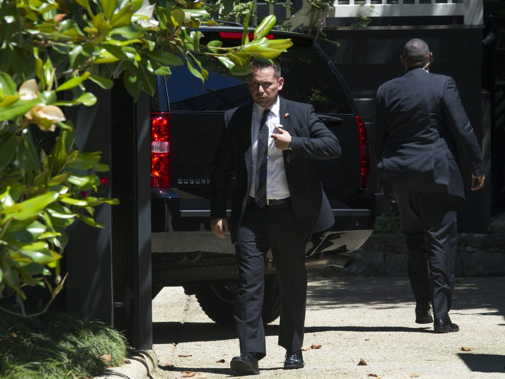 Secret Service stand guard around a Secret Service vehicle after it arrived at the home of Democratic presidential candidate Hillary Clinton in Washington, Saturday, July 2, 2016. The Clinton campaign says the FBI interviewed Clinton on Saturday morning in Washington, about her emails while she was secretary of state. (AP Photo/Cliff Owen)