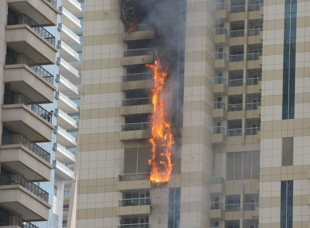 Flames are seeen after a fire broke out at residential Sulafa tower in the upscale Marina district in Dubai July 20, 2016. REUTERS/Ahmed Jadallah