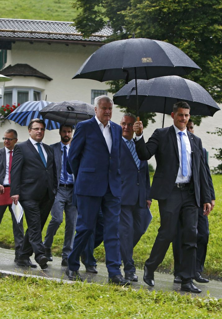 Bavarian state premier and leader of the Christian Social Union (CSU) Horst Seehofer (C), Bavarian Interior Minister Joachim Herrmann (3rd R) and Bavarian Justice Minister Winfried Bausback (2nd L) arrive for a news conference in Sankt Quirin, Germany, July 26, 2016. REUTERS/Michaela Rehle