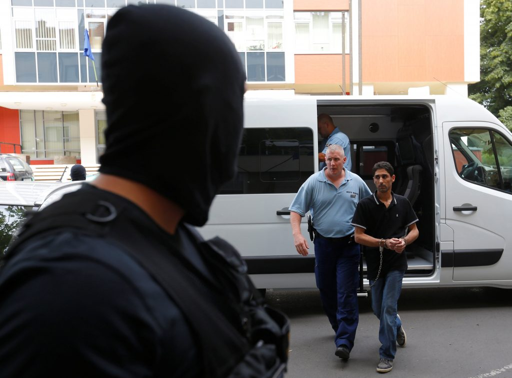 Police escort to the court a Syrian migrant who was put on trial for illegal border crossing, ahead of his court sentencing in Szeged, Hungary, July 1, 2016. REUTERS/Laszlo Balogh