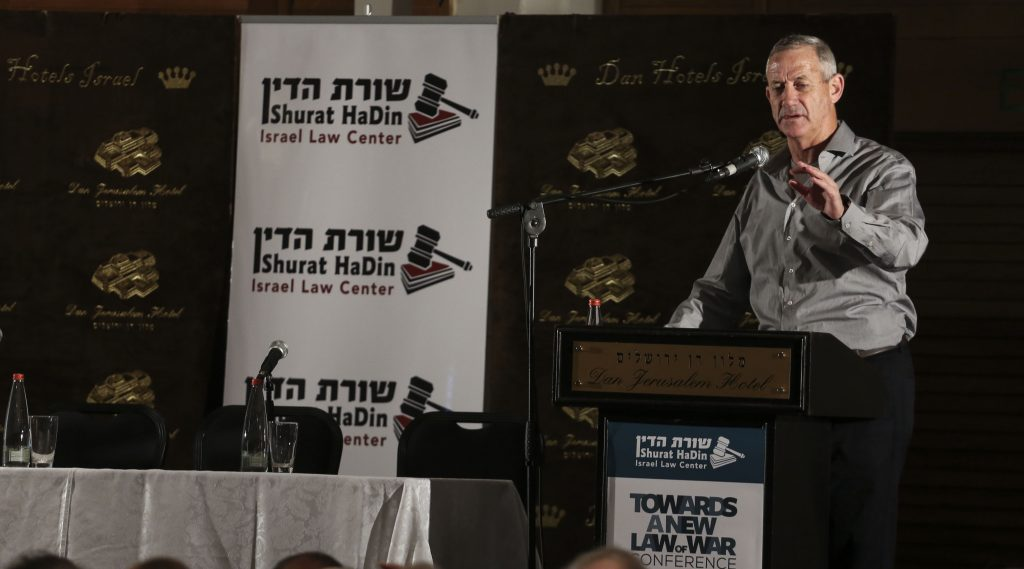 "Former IDF Chief of Staff, Benny Gantz, speaks during the conference ""Towards a New Law of War"" held by Shurat HaDin, Israel Law Center, at the Dan Hotel, Jerusalem, on May 4, 2015. Photo by Hadas Parush/Flash90 *** Local Caption *** בני גנץ רמטכ״ל לשעבר שורת הדין חוק חוק מלחמה לחימה חוקים קונפליקט טרור כנס ירושלים"