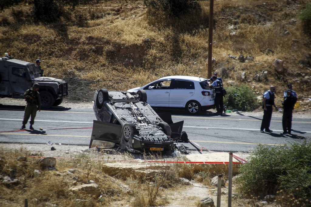 Israeli security forces at the scene of the terror attack on Route 60, near Otniel, on Friday. (Wisam Hashlamoun/Flash90)
