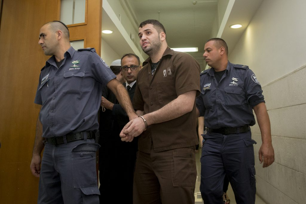 Bilal Abu Ghanem, is escorted by Israeli prison officers at the District court in Jerusalem on July 11, 2016. Bilal Abu Ghanem carried out a terror attack together with his friend last year on a bus in Armon Hanatziv neighborhood in which three people were killed. Photo by Yonatan Sindel/Flash90 *** Local Caption *** רצח נסיון רצח ארמון הנציב אוטובוס בלאל אבו גאנם ג'אבל מוכאבר בית משפט מחוזי טרור