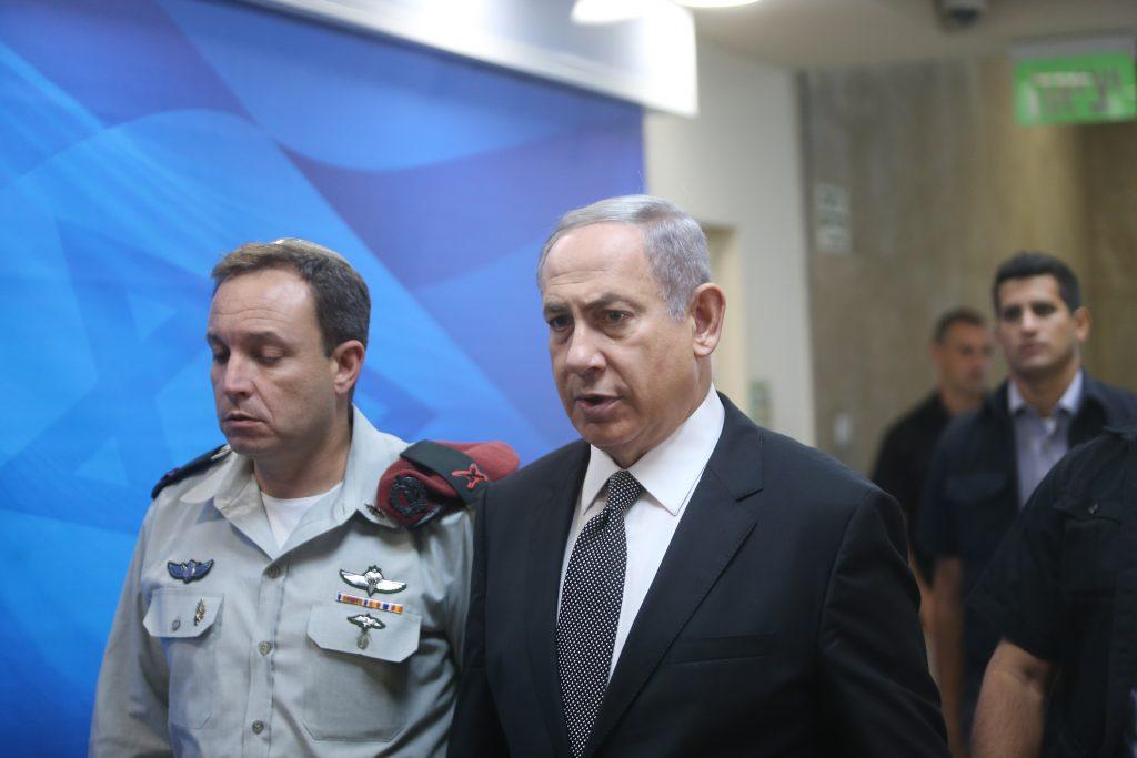 Israeli Prime Minister Benjamin Netanyahu arrives to the weekly government conference at PM Netanyahu's office in jerusalem on July 17, 2016. Photo by Alex Kolomoisky/POOL *** Local Caption *** éùéáú îîùìä áðéîéï ðúðéäå áéáé