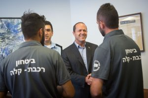 Jerusalem District Police Commander, Yoram Halevi, and Jerusalem mayor Nir Barkat meet and congratulate the lightrail security who earlier this morning stopped and prevented a Palestinian man who admitted to having explosives and planned to bomb the Jerusalem Light Train, on July 17, 2016. Photo by Miriam Alster/Flash90 *** Local Caption ***  פיגוע מטען חבלה ראש העיר ניר ברקת ביטחון אבטחה מפקד מחוז ירושלים יורם הלוי