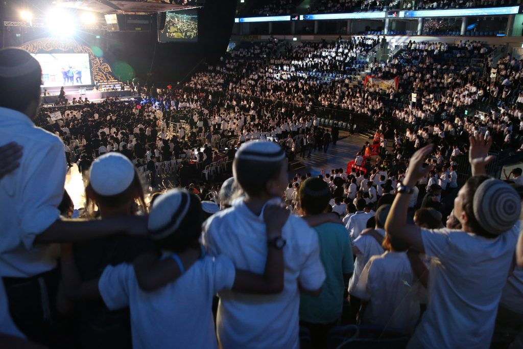 Thousands of students who attend the Shas-affiliated Mayan Chinuch–Bnei Yosef Education Network gathered at Binyanei Ha'umah in Yerushalayim on Monday. (Yaacov Cohen/Flash90)