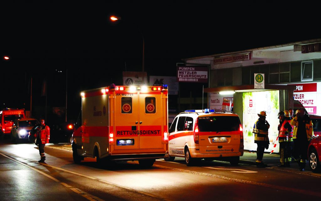 German emergency services workers work in the area of Monday's terror attack in Wuerzburg, Germany early Tuesday. (Reuters/Kai Pfaffenbach)