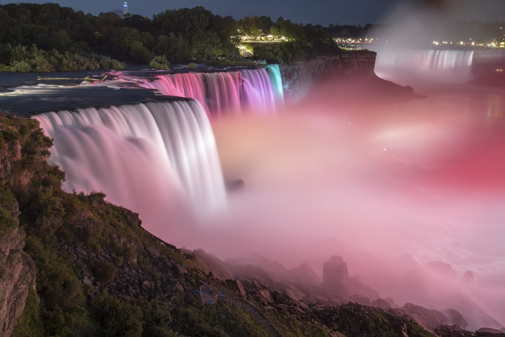 The American side of Niagara Falls is lit up Sunday night, shortly before a dramatic rescue of a boat as it was drifting closer to the falls. (CanonOlli/Flickr)