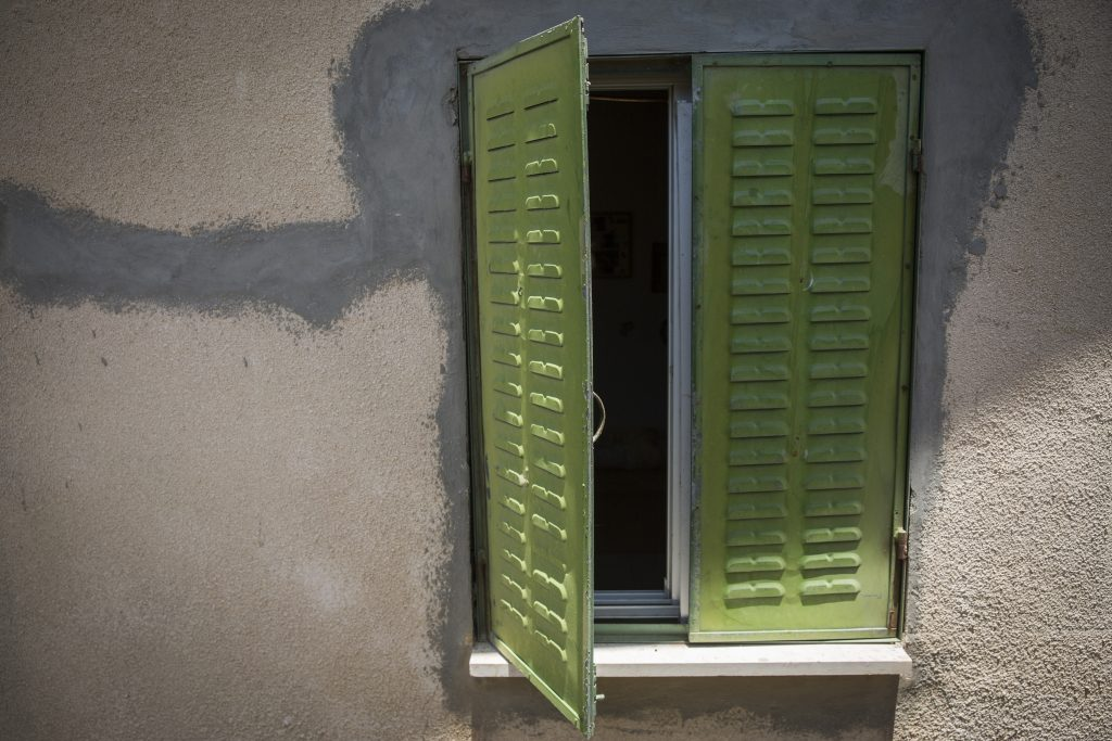 """The window to the bedroom of Hallel Yaffa Ariel, Hy""""d, 13, who was stabbed and killed in a terror attack in Kiryat Arba on June 30. The family of her murderer, who was shot dead, is now eligible for support from the Palestinian """"martyrs'"""" fund. (Hadas Parush/Flash90)"""