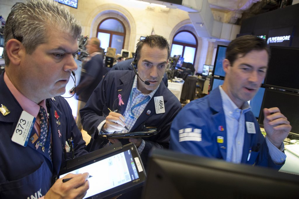 Traders on the floor of the New York Stock Exchange on Friday. (AP Photo/Mark Lennihan)