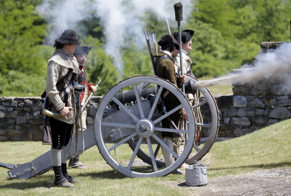 Historical interpreters fire a cannon during an afternoon demonstration at Fort Ticonderoga earlier this month. (AP Photo/Mike Groll)