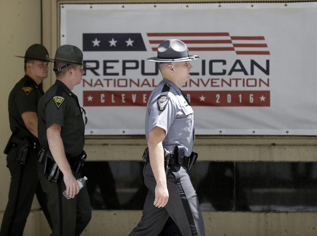 Ohio State Highway Patrol troopers walk outside of Quicken Loans Arena in Cleveland on Sunday, as preparations take place for the Republican National Convention. (AP Photo/Matt Rourke)