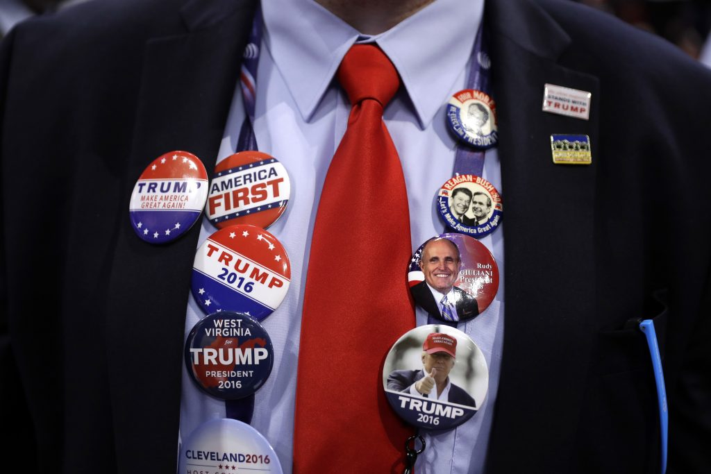 Caleb Turner, from Hurricane, W.Va., shows off his button collection at the Republican National Convention. (AP Photo/Matt Rourke)