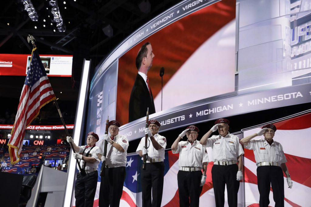 Color guards salute during the national anthem on Monday, the first day of the Republican National Convention in Cleveland. (AP Photo/John Locher)