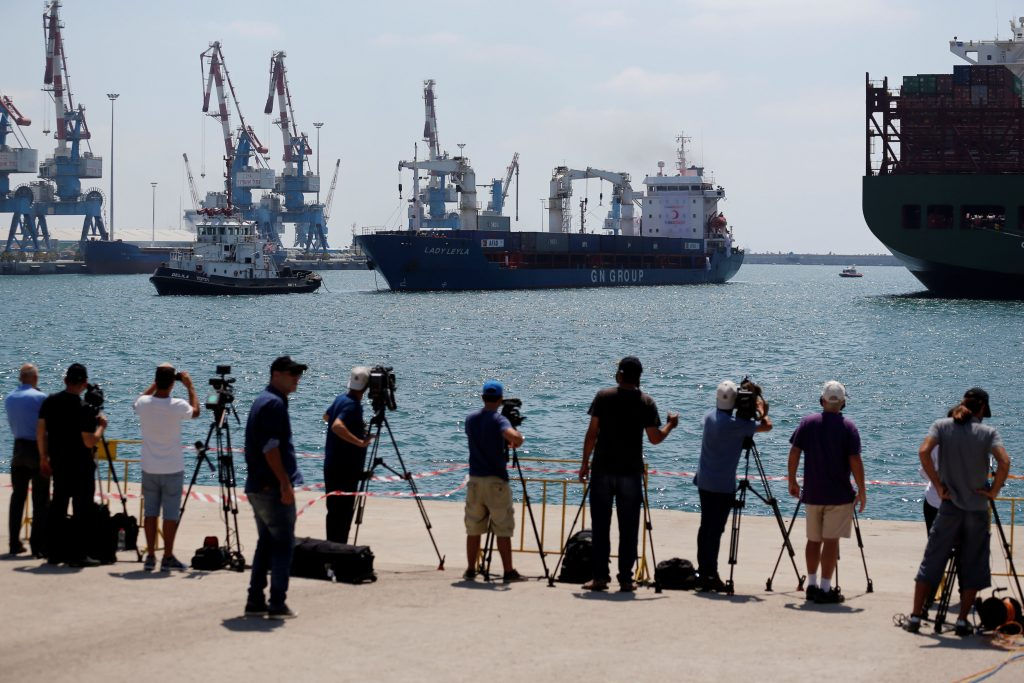 Members of the press filming the Panama-flagged Lady Leyla (C), a Turkish ship carrying humanitarian aid to Gaza, as it entered Ashdod port on Sunday. (Reuters/Amir Cohen)