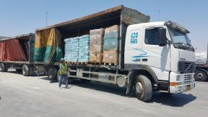 The first truck from the Turkish transport ships arrived from Ashdod Port to the Kerem Shalom crossing. The truck contained a shipment of toys (dolls and teddy bears), as well as diapers, in cartons bearing the Turkish flag. (Ministry of Defense Crossing Authority)