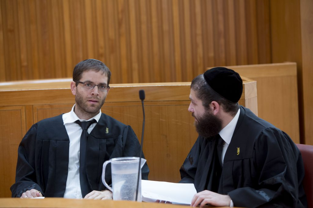 Israeli lawyers seen in the High Court in Yerushalayim before the start of a hearing on  petitions to cancel the reconciliation agreement between Israel and Turkey. (Yonatan Sindel/Flash90)