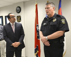 Josh Devine, of the Tennessee Bureau of Investigation (L), looks on as Bristol Police Chief speaks about shootings, on Thursday. (David Crigger/The Bristol Herald-Courier via AP)