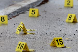 Dozens of shell casings lie on the ground at the crime scene. (David Crigger/The Bristol Herald-Courier via AP)