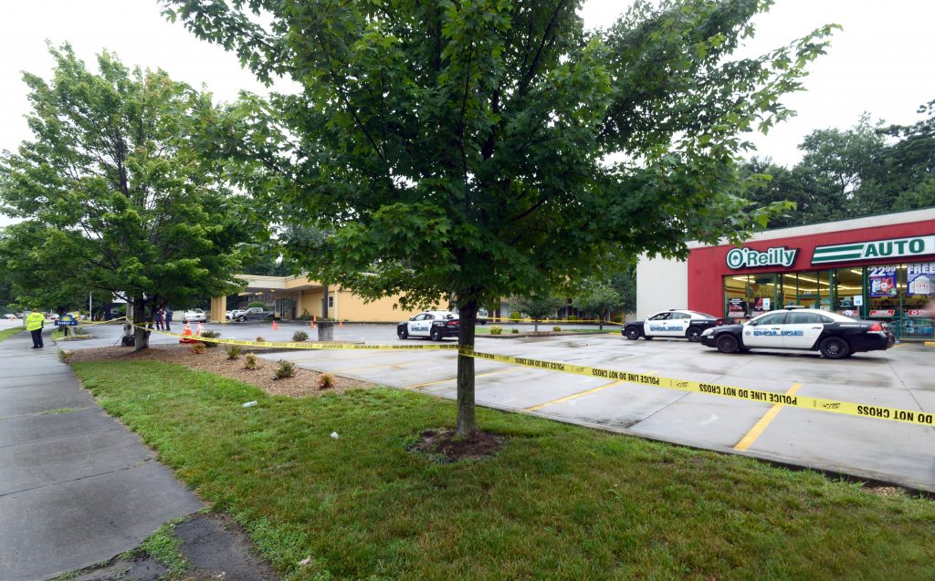 At the scene of the shootings, near a Days Inn and an O'Reilly Auto Parts store on Volunteer Parkway in Bristol, Tenn. scene of an overnight shooting in Bristol, Tenn. (David Crigger/The Bristol Herald-Courier via AP)