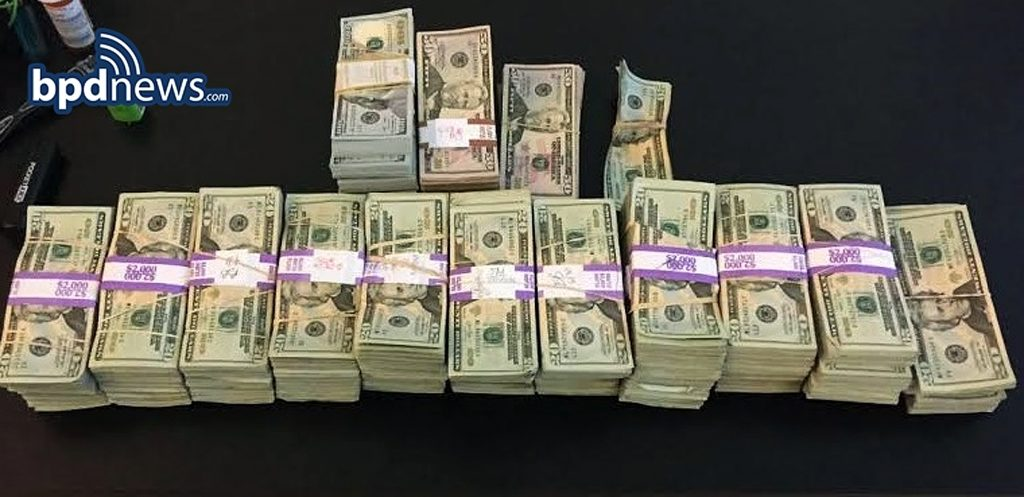 The stacks of money left in a Boston taxi. (Boston Police Department via AP)