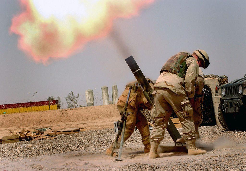 American soldiers firing an Israeli-made M120 mortar, non-reusable.