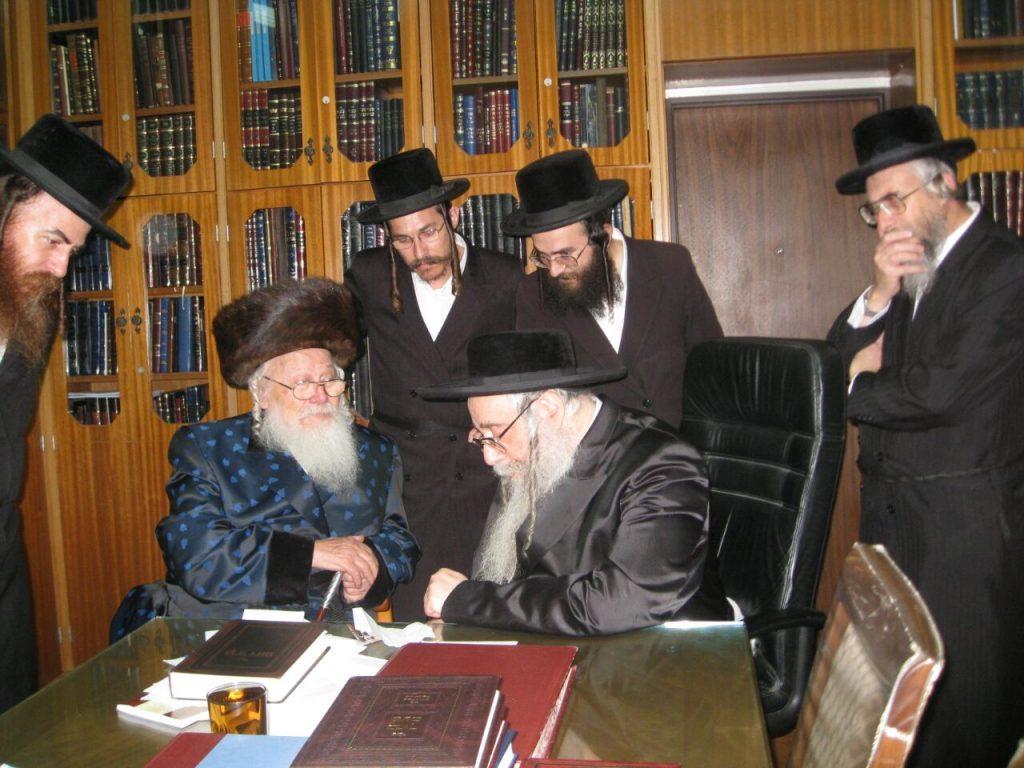 "The Binyamina Rebbe, zt""l (L) visits the Sanzer Rebbe , shlita, (R) in Netanyah. (Moshe Goldstein)"