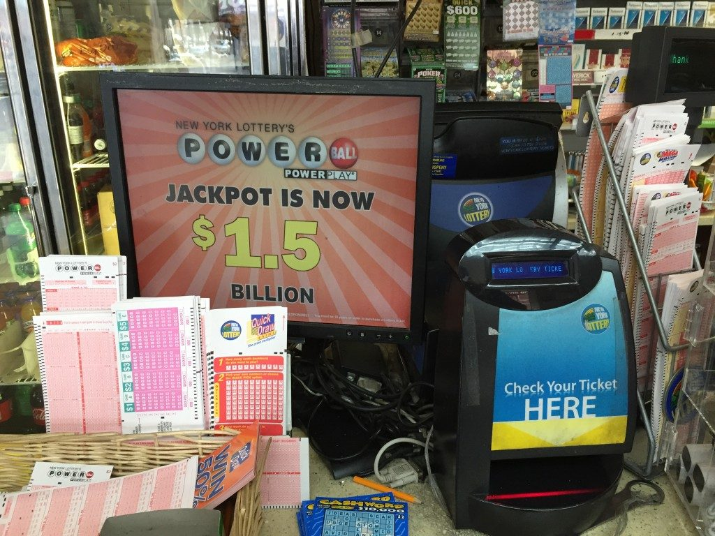 A lotto sign in a Brooklyn deli shortly before the record Powerball drawing displays the prize amount, which later rose to $1.6 billion. (Isser Berg/Hamodia)