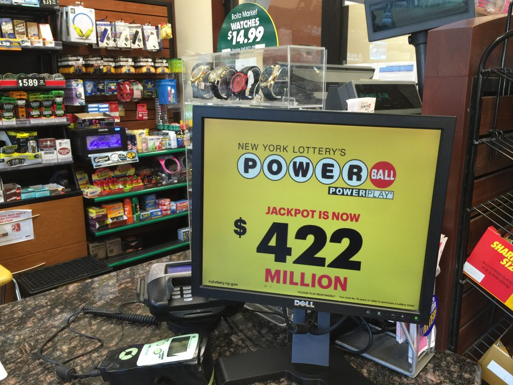 A lotto sign in a Brooklyn displays the amount of Wednesday night's Powerball jackpot. (Isser Berg/Hamodia)