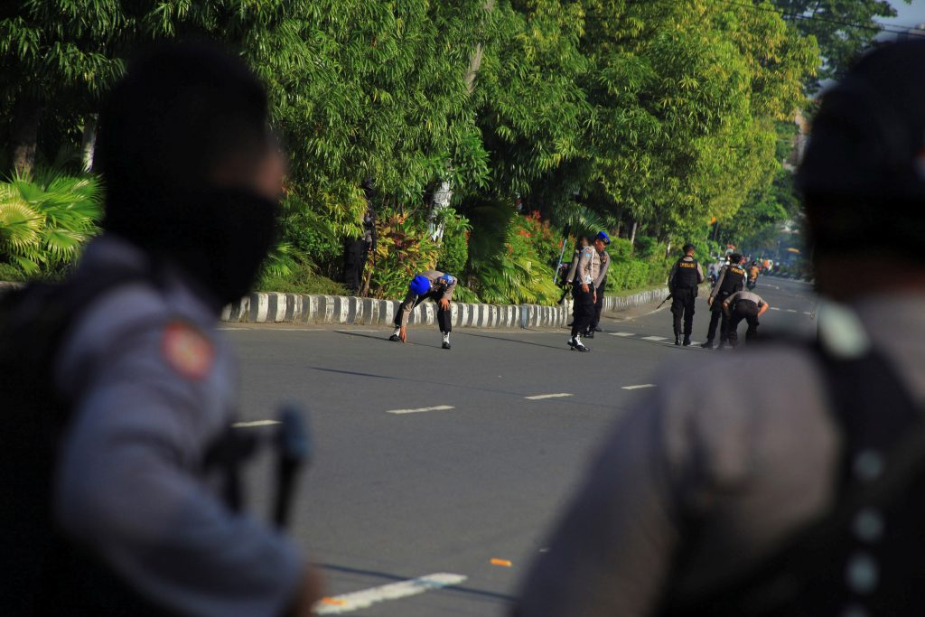 Police comb the street looking for bomb fragments outside a police station following an attack in Solo, Central Java, Indonesia on July 5, 2016 in this photo taken by Antara Foto. A suicide bomber on a motorcycle attacked a police station in the small Indonesian city of Solo on Tuesday, killing himself and wounding a police officer, a police spokesman said. Antara Foto/Maulana Surya/via REUTERSATTENTION EDITORS - THIS IMAGE HAS BEEN SUPPLIED BY A THIRD PARTY. IT IS DISTRIBUTED, EXACTLY AS RECEIVED BY REUTERS, AS A SERVICE TO CLIENTS. FOR EDITORIAL USE ONLY. NOT FOR SALE FOR MARKETING OR ADVERTISING CAMPAIGNS MANDATORY CREDIT. INDONESIA OUT. NO COMMERCIAL OR EDITORIAL SALES IN INDONESIA.