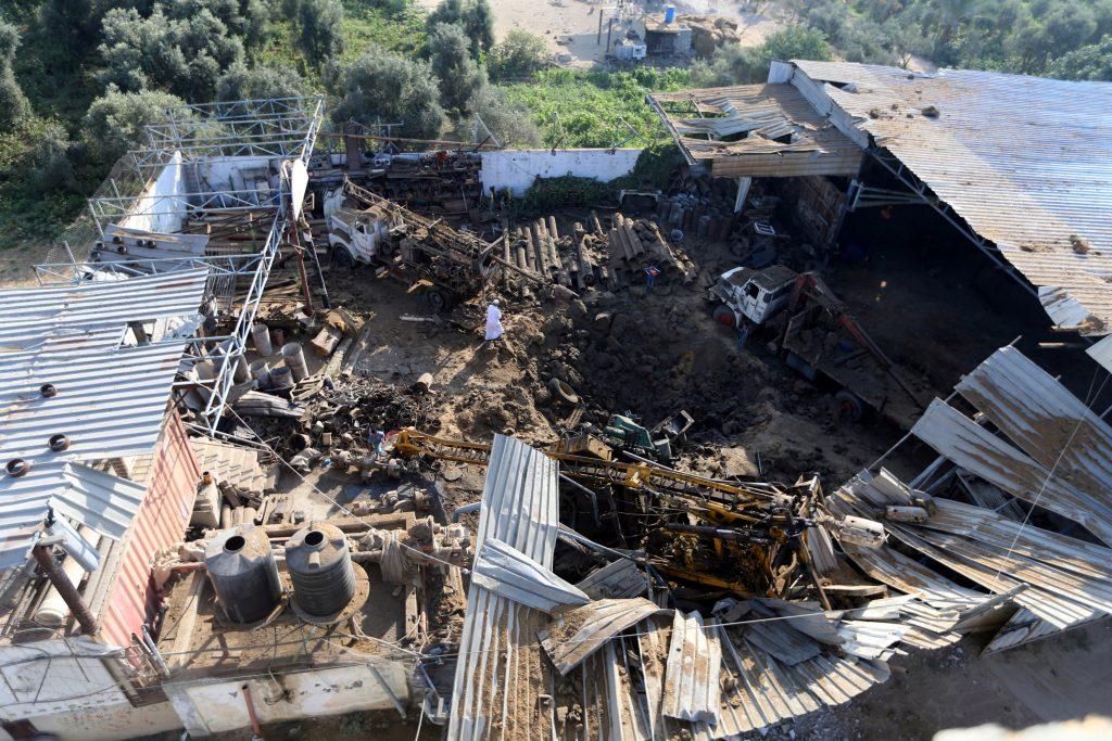 A Palestinian man inspects the site of an Israeli air strike in Gaza City July 2, 2016. REUTERS/Ibraheem Abu Mustafa