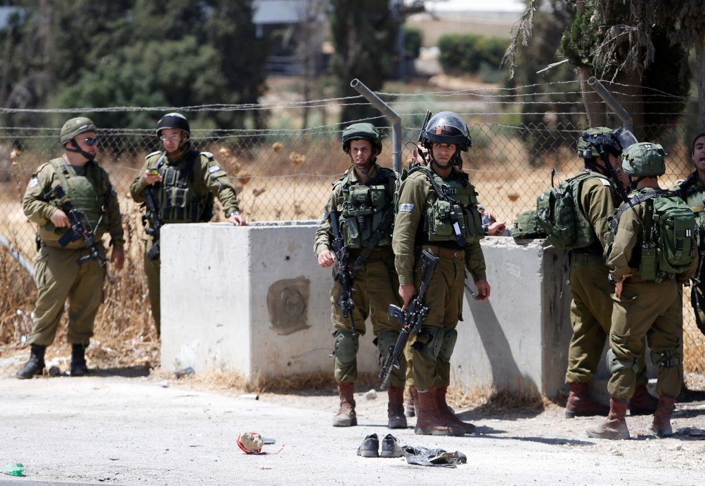 Israeli soldiers gather at scene of a stabbing attack near Arroub refugee camp near the West Bank city of Hebron July 18, 2016. REUTERS/Mussa Qawasma TPX IMAGES OF THE DAY