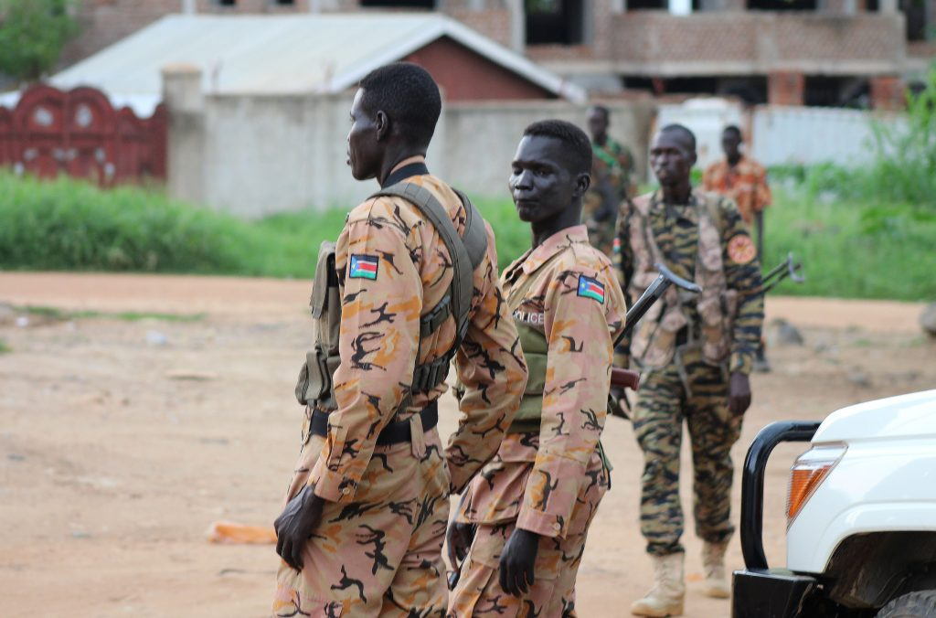 South Sudanese policemen and soldiers stand guard along a street in South Sudan's capital, Juba. (Reuters/Stringer)
