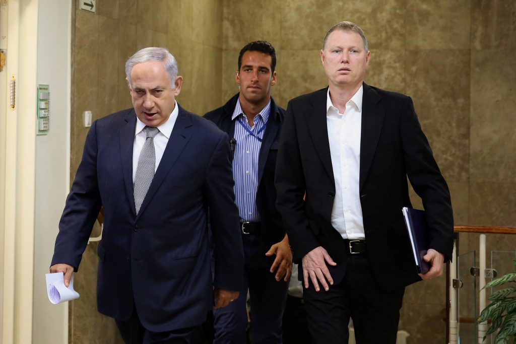 Israeli Prime Minister Binyamin Netanyahu (L) arrives at the weekly cabinet meeting on Sunday. (Reuters/Gali Tibbon/Pool)