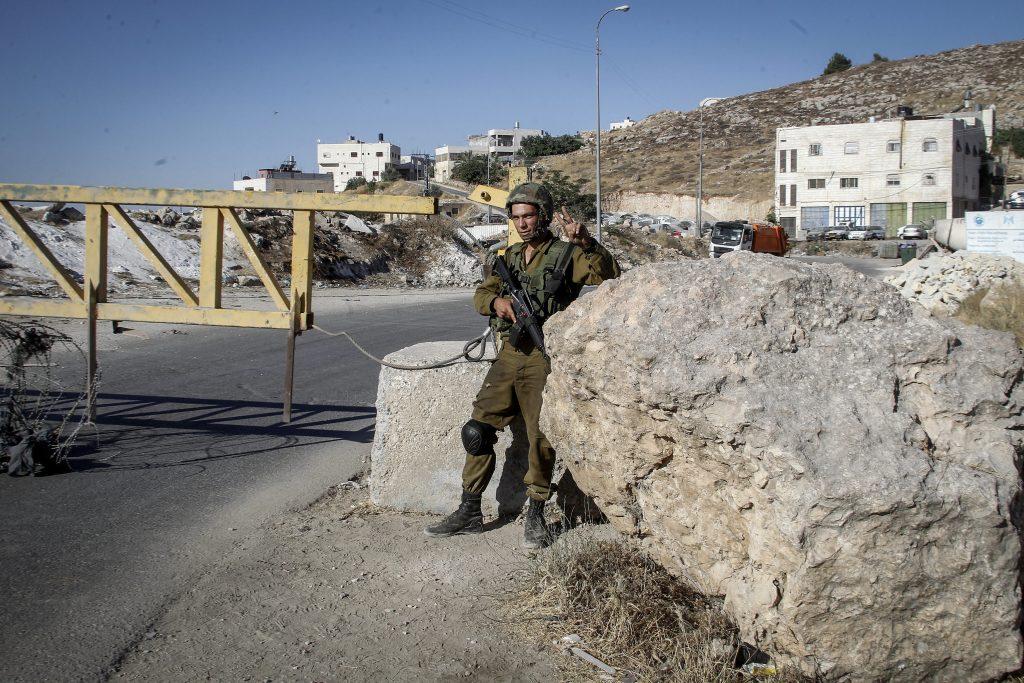 An Israeli military checkpoint. (Wisam Hashlamoun/Flash90)
