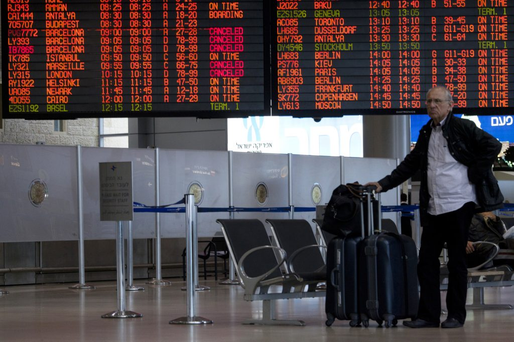 A passenger waiting by his luggage in the departure hall at Israel's Ben Gurion International Airport. (Flash90)