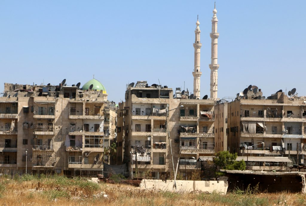 Buildings are pictured near the road, which was believed to be used by civilians to access one of the safe exit points opened for civilians intending to leave rebel-held areas, in Aleppo's Bustan al-Qasr, Syria July 29, 2016. REUTERS/Abdalrhman Ismail