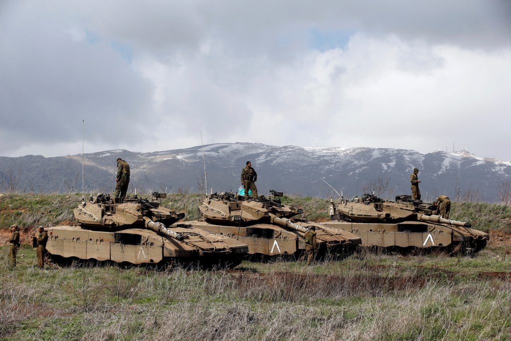 Israeli soldiers stand atop tanks in the Golan Heights near Israel's border with Syria March 19, 2014. REUTERS/Ronen Zvulun/File Photo