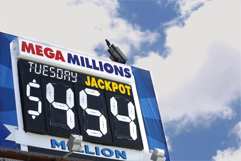 An electronic billboard displays the current Mega Millions jackpot in Springfield, Ill., on Tuesday. (AP Photo/Seth Perlman)
