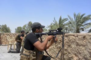Iraqi soldiers during a military operation to regain control of villages north of Ramadi on Saturday. (AP Photo)