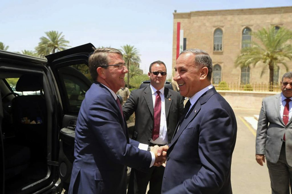 U.S. Defense Secretary Ash Carter, left, shakes hands with Iraqi Defense Minister Khaled al-Obeidi at the Ministry of Defense in Baghdad, Iraq, on Monday. (AP Photo)