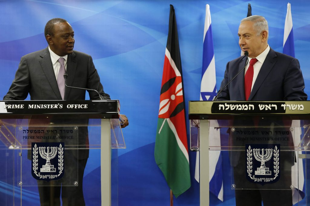FILE -- In this Feb. 23, 2016 file photo, Kenya's President Uhuru Kenyatta, left, stands next to Israeli Prime Minister Benjamin Netanyahu as they deliver joint statements in Jerusalem. Netanyahu heads to Africa this week, where Israel has found much-needed partners in the battle against Islamic militants and allies in countering the rising Palestinian influence at the United Nations. Netanyahu will also visit the site where his brother was killed in a 1976 military raid on a hijacked airliner in Uganda, a seminal event that helped cement his hard-line ideology. (Amir Cohen, Pool via AP, File)