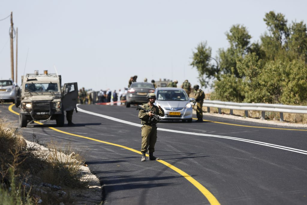 Israeli soldiers at the scene of the tragic attack Friday. (AP Photo/Nasser Shiyoukhi)