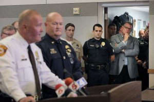 Police officers listen as St. Louis County Police Chief Jon Belmar, left, and Ballwin Police Chief Kevin Scott speak during a news conference Friday in Ballwin, Mo. (Huy Mach/St. Louis Post-Dispatch via AP)