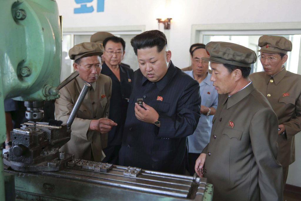 North Korean leader Kim Jong Un (C) visits the Sinuiju Measuring Instrument Factory in this undated photo released by North Korea's Korean Central News Agency (KCNA) in Pyongyang September 4, 2015. REUTERS/KCNA/File Photo ATTENTION EDITORS - THIS PICTURE WAS PROVIDED BY A THIRD PARTY. REUTERS IS UNABLE TO INDEPENDENTLY VERIFY THE AUTHENTICITY, CONTENT, LOCATION OR DATE OF THIS IMAGE. FOR EDITORIAL USE ONLY. NOT FOR SALE FOR MARKETING OR ADVERTISING CAMPAIGNS. THIS PICTURE IS DISTRIBUTED EXACTLY AS RECEIVED BY REUTERS, AS A SERVICE TO CLIENTS. NO THIRD PARTY SALES. SOUTH KOREA OUT. NO COMMERCIAL OR EDITORIAL SALES IN SOUTH KOREA