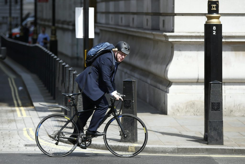 Boris Johnson rides his bike along Whitehall in London on July 6. (Reuters/Peter Nicholls)