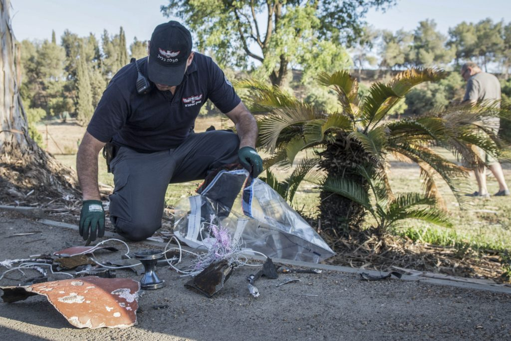 Israeli security forces examine debris from the Patriot Missiles fired on Sunday in Kibbutz Ayelet Hashahar in northern Israel. (Basel Awidat/Flash90)