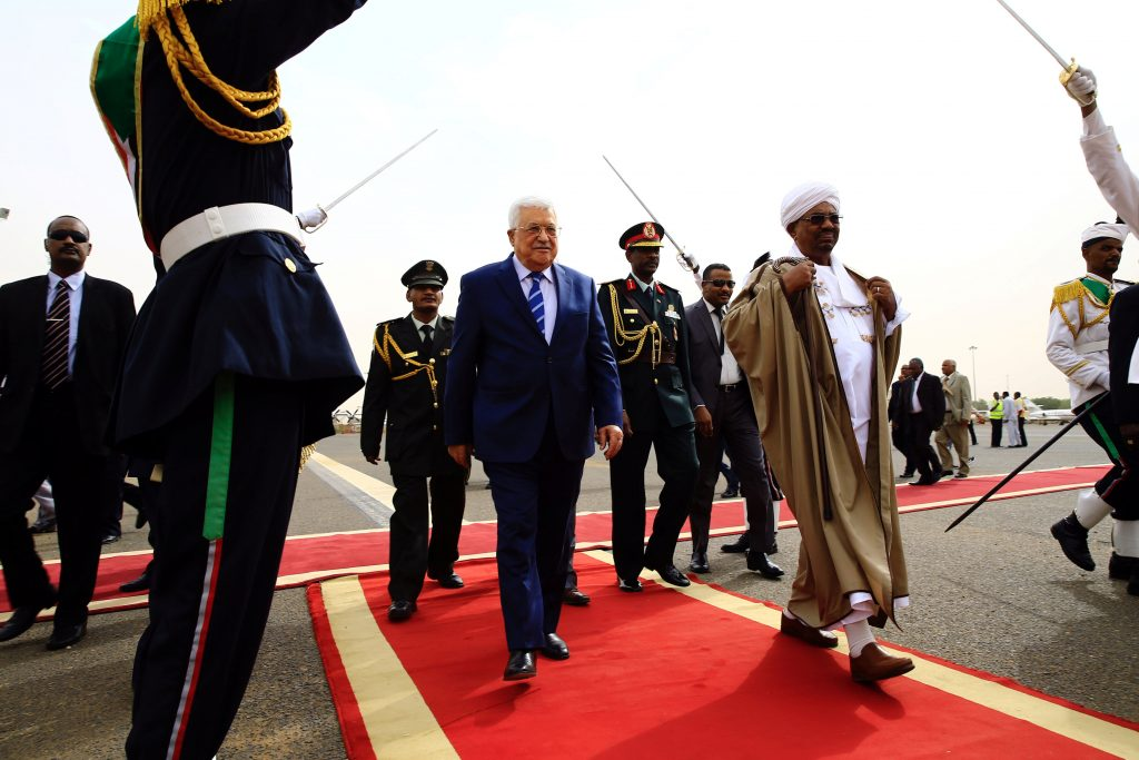 Sudanese President Omer Hassan AlBashir Welcomes Palestinian Authority President Mahmoud Abbas at Khartoum Airport in Sudan on Tuesday. (Reuters/Mohamed Nureldin Abdallah)